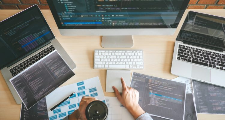 Professional Developer programmer working a software website design and coding technology, writing codes and database in company office, Global cyber connection technology.